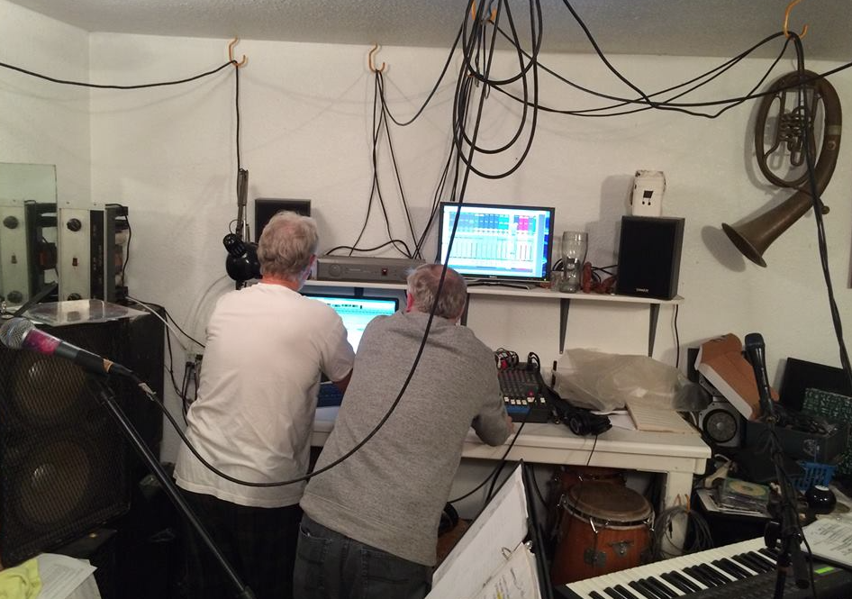 Chris and Tom working on digitally mastering music in the studio